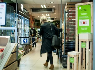 3. Woman walking into supermarket_small